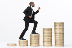Business Man Climbing Coin Stacks Stock Photography