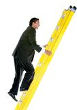 Business man climbing a ladder Stock Photo