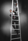 Business man climbing ladder_3 Royalty Free Stock Photography