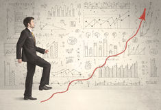 Business man climbing on red graph arrow concept Stock Photo