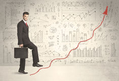 Business man climbing on red graph arrow concept Stock Photos