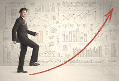 Business man climbing on red graph arrow concept Royalty Free Stock Photo