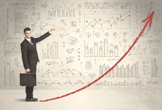 Business man climbing on red graph arrow concept Royalty Free Stock Photography
