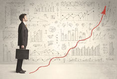 Business man climbing on red graph arrow concept Stock Image