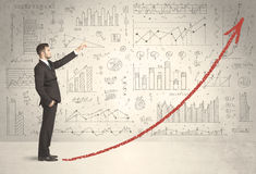 Business man climbing on red graph arrow concept Royalty Free Stock Photos