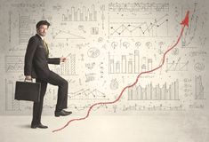 Business man climbing on red graph arrow concept. On background Stock Photos
