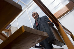 Business man climbing stairs Stock Image