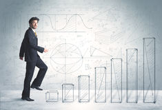 Business man climbing up on hand drawn graphs concept Royalty Free Stock Photography