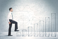 Business man climbing up on hand drawn graphs concept Royalty Free Stock Images
