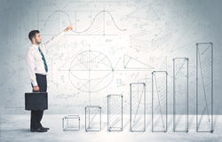 Business man climbing up on hand drawn graphs concept Stock Photography