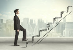 Business man climbing up on hand drawn staircase concept Stock Photo