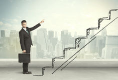 Business man climbing up on hand drawn staircase concept Royalty Free Stock Photos