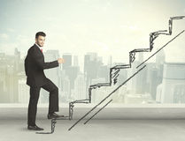 Business man climbing up on hand drawn staircase concept Royalty Free Stock Images