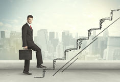 Business man climbing up on hand drawn staircase concept Stock Photos