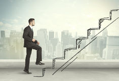 Business man climbing up on hand drawn staircase concept Royalty Free Stock Image