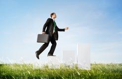 Business Man Climbing Up Steps Outdoors Concept.  stock photos