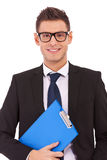 Business man with a clipboard Royalty Free Stock Photography