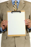 Business man and clipboard. Man in business suit holding blank clipboard - copy space Royalty Free Stock Photos