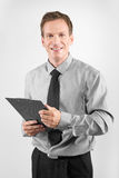 Business man with clipboard Stock Photography