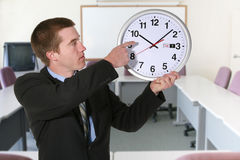 Business Man and Clock Royalty Free Stock Photos