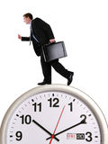 Business Man on Clock Stock Photo