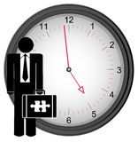 Business man on the clock Stock Photo