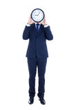 Business man with clock covering face isolated on white Royalty Free Stock Photo