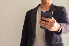 Business Man. Close up business man hold a smart mobile Stock Photography
