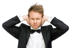 Business man with closed eyes closes his ears Stock Image