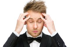 Business man with closed eyes putting hands on head Royalty Free Stock Image