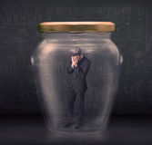 Business man closed into a glass jar concept Royalty Free Stock Photography