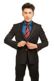 Business man closing button of suit Stock Image