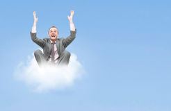 Business man on cloud. Business man on a cloud stock photography