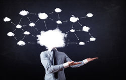 Business man with cloud network head Stock Photo