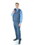 Business man with with coat hanging over shoulder. Smiling and looking straight full shot Royalty Free Stock Photos