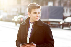 Business man in coat using tablet Stock Photos