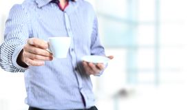Business man with coffee cup Royalty Free Stock Image