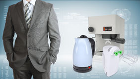 Business man with coffee machine, kettle and Royalty Free Stock Photo