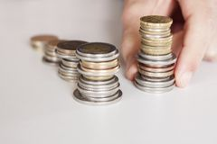 Business man with coins Stock Images