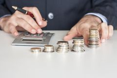 Business man with coins Royalty Free Stock Image