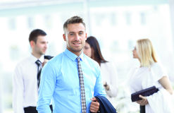 Business man with colleagues at the back Royalty Free Stock Images