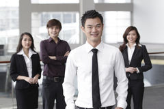Business man with colleagues in the background Royalty Free Stock Images