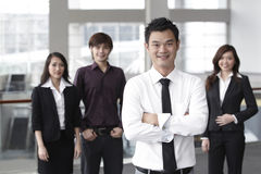 Business man with colleagues in the background Stock Photography