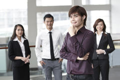 Business man with colleagues in the background Stock Photo