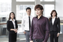 Business man with colleagues in the background Royalty Free Stock Image
