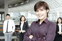 Business man with colleagues in the background Stock Photos
