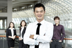 Business man with colleagues in the background Royalty Free Stock Photography