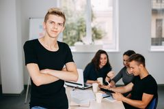 Business man with colleagues meeting behind him stock photos