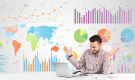 Business man with colorful charts. Graphs Stock Images