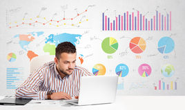 Business man with colorful charts. Graphs Royalty Free Stock Image